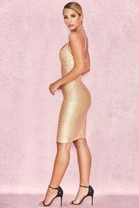 Material: Rayon, Nylon, Spandex Very stretchy bandage fabric with metallic finish Hugs your curves to perfection no matter your body shape Metallic gold dress Flattering cross bust Bodycon fit Sexy Dresses, Gold Bodycon Dresses, Beautiful Dresses, Short Dresses, Fashion Dresses, Bandage Dresses, Women's Fashion, Mini Dresses, Sexy Outfits