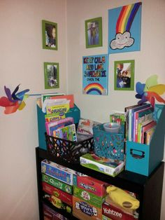 Kids' Bedroom Display & Decor...green frames were on clearance from Target, 2 pack canvas was from Michael's on sale (which my friends and I painted) and all of the baskets/file holders were also clearance from Target (everything for less than $13)