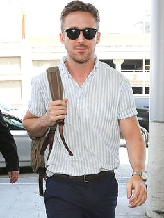 Star Tracks: Monday, May 19, 2014 | HELLO, HANDSOME | Where you going, Ryan? Gosling holds on to his backpack as he heads into Los Angeles International Airport on Sunday.