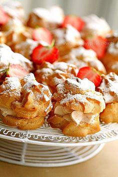 Cream puffs with strawberry cream - profiterole, cream puff (US) or choux à la crème