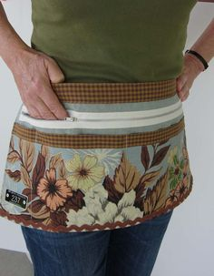 Great craft vendor apron. http://www.etsy.com/listing/78252237/vintage-40s-7-pocket-apron
