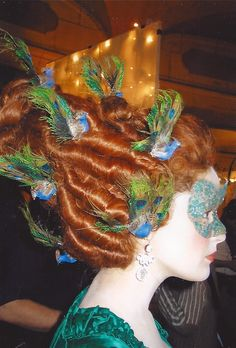 his wig with peacock feathers was created by hair and wig designer Desiree Corridoni.