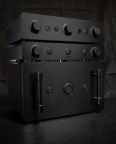 Sugden Masterclass series in custom Stealth finish. From the bottom: power amp, pre-amp, integrated amp Audiophile Speakers, Hifi Audio, Drones, Audio Design, Audio Room, High End Audio, Wall Mounted Tv, Loudspeaker, Audio Equipment