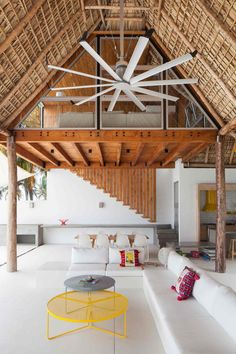 colorful-tropical-open-home-rough-cut-thatched-roof-4-tall-indoors.jpg