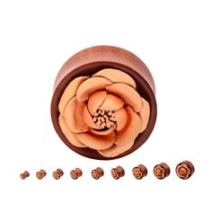 Organic plugs made from red saba wood. These plugs are adorned with a peach leather flower on the front. Sold as a pair. Carved by Hand from the Master Carvers of Bali. Due to the nature of organics t