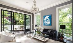 Great mix of sleek and modern steel doors with traditional touches like the chandelier