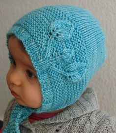 """The Petites Feuilles (""""little leaves"""" in French) bonnet is an irresistible and practical baby bonnet that works up in no time and is completely seamless. It features a lovely and easy leaf motif. The front of the bonnet is knit flat, the crown is knit in the round. Stitches are picked up to make ties. The pattern is both fully written and charted.Skills Required: casting on, knitting, purling, knitting in the round, increasing, decreasing, yarn over, picking up stitches, binding off..."""