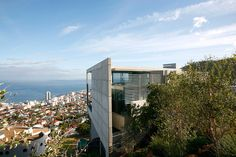 Concrete postmodern architecture on a steep hillside with distance views of the ocean in Cape Town? Uh, ok.