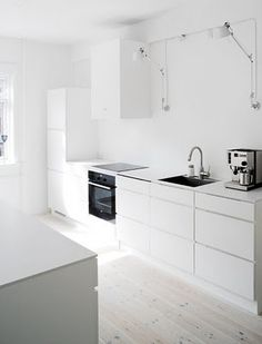 All white interiors on pinterest white kitchens modern for Bleached wood kitchen cabinets
