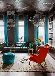 Turquoise curtains, emerald green chesterfield sofa and red-orange chair. Living Etc Oct. 2014
