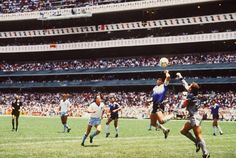 """Maradona scoring a goal with his hand during the quarter final 1986 FIFA World Cup in Mexico, known as the """"Hand of God"""""""