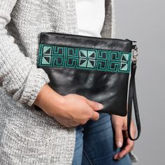 """Our Tariq Masir Wristlet is hand embroidered with a traditional """"Road of Egypt"""" motif from Palestine. handcrafted by amazing artisans in the West Bank. Soon it will also be available in rose gold. We can't wait 😍 Clutch Bag, Crossbody Bag, Trade Federation, Ethical Fashion Brands, Sustainable Fashion, Leather Purses, Egypt, Messenger Bag, Artisan"""