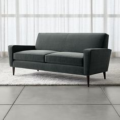Shop Torino Blue Velvet Modern Apartment Sofa. Sized for smaller rooms, the apartment sofa adds retro-turned-modern flair to the casual family room. The Torino Velvet 2-Seat Apartment Sofa is a Crate and Barrel Exclusive.
