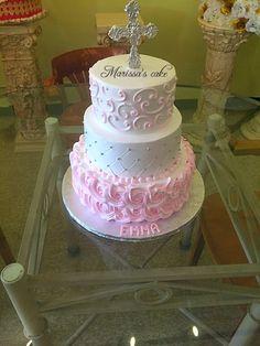 Rosettes baptism cake. Visit us Facebook.com/marissascake or www.marissascake.com