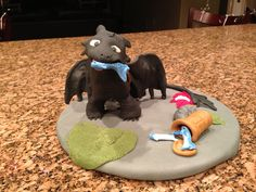 Toothless cake topper. (My son wanted cheesecake so I made him on a cardboard cake round and placed it on top)