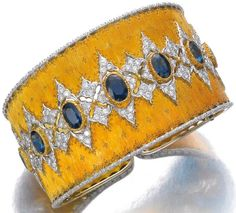 Gold, sapphire and diamond bangle, Buccellati. Via Diamonds in the Library.