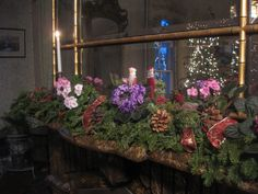 Christmas mantel decor, with a violet colored, African Violet plant