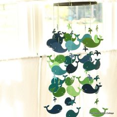 Make your own baby mobile with these step by step instructions. A fun project that will look great in any nursery.