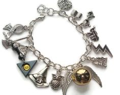 Harry Potter Charm Bracelet - Harry Potter Bracelet - Potter Jewelry - Hogwarts Bracelet - Golden Snitch Locket - Hermoine - Deathly Hallows by BellaAniela on Etsy https://www.etsy.com/listing/190088078/harry-potter-charm-bracelet-harry-potter