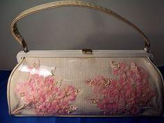 Vintage 1950s silk flowers in semi sheer plastic handbag