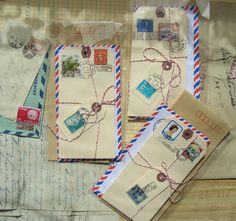 Postal theme. The classic red and blue striped envelope and manila tags offer just the right touches.