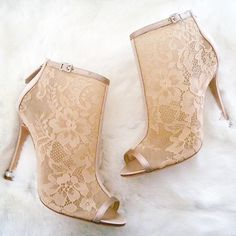 Lace booties for a winter wedding. Yes please. Nude lace with rhinestone buckle and ring at the heel by Badgley Mischka.