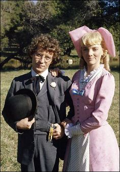 Nellie Oleson and Percival Dalton/ Isaac Cohen-  Little House on the Prairie were married on very short notice.Nellie wore a lovely pink brocade gown which had a hidden hook-and-eye closure down the back. It also had a low neckline filed in with white taffeta. She also wore an enormous pink bow in her blonde curled wig. (Front view)