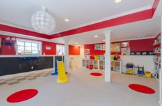 wonderful basement playroom ideas... love the chalkboard, storage, wall & ceiling paint accents, minus the spots on the floor