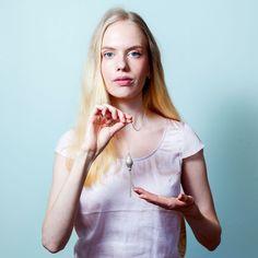 Model wearings Aurelia pendant. Handmade in Finland.