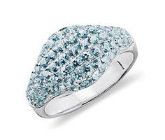 It's not my birthstone but I love the look and the color. Blue Topaz Ring in Sterling Silver made with SWAROVSKI GEMSTONES