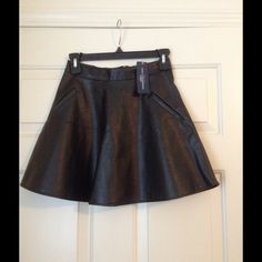 *NWT* Chic Black Vegan Leather Skirt (S) *NWT* Chic Black Vegan Leather Skirt. Size small. Brand new with tags. Moving out of state soon and will sadly have to part with most of my high quality clothing. My loss is your gain! Brand: One Clothing. one clothing Skirts