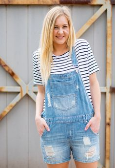Denim shortall. This super hot trend is a must have this Summer! This destroyed denim pair of shorts overalls is what every trendy gal needs! We love it worn over a crop top for a super cute trendy lo