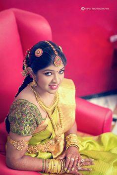 South Indian bride. Temple jewelry. Jhumkis.Green silk kanchipuram sarees with embroidered blouse.Braid with fresh jasmine flowers. Tamil bride. Telugu bride. Kannada bride. Hindu bride. Malayalee bride.Kerala bride.South Indian wedding.