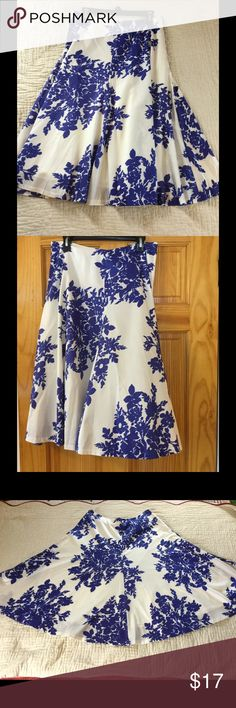 GAP Floral skirt Beautiful flare skirt.  Has an elegant shine. 100% cotton with lining. Worn once. Gap Skirts Midi