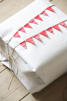 ✂ That's a Wrap ✂ diy ideas for gift packaging and wrapped presents - washi tape bunting gift wrap