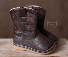 "Every ""southern tot"" needs a pair of cowgirl boots. Adorable dark brown leather boots with stitched detailing just like Mommy and Daddy's. Squeaker can easily be removed by an adult. Please note that these run 1/2 size large and to reference the sizing chart before ordering as all shoe sales are final. Get them before they are gone!   <a href=""http://www.southerntots.com/wp-content/uploads/PreOrderBanner-e1407511275792.jpg""><img class=""alignnone size-medium wp-image-11633"" alt=""Preorder ..."