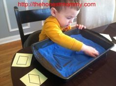 Use colored sand in a pan to let your toddler practice drawing shapes - or for your preschooler to write letters!