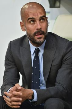 Head coach Josep Guardiola of FC Bayern Muenchen looks on prior to. Pep Guardiola Style, Bald Men Style, Bald With Beard, Suit Combinations, Most Stylish Men, Best Dressed Man, Beard Styles, Mens Suits, Men Casual
