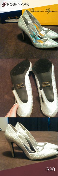 Sparkled heels!! Bling! Brand new!! Only worn to model. Still has tags and box . Super cute and the crystals sparkle w each movement. Bought to go w the wedding dress never happened... marichi mani Shoes Heels