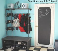 pipe shelves and diy bench for a mini mudroom, chalk paint, laundry rooms, organizing, shelving ideas, An industrial look with pipe shelving and a chalkboard door