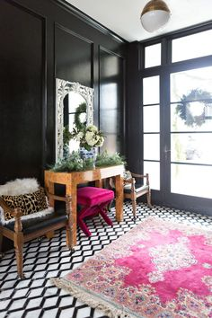 CC and Mike's Modern Eclectic Christmas Home Tour, black and white marble floors, marble floors, entryway design, black high gloss walls, black paneling, wood paneling, modern eclectic decor, glam decor, burl wood, leopard pillows, CC and Mike's Modern Eclectic Christmas Home Tour, Christmas front porch ideas, holiday porch, holiday front porch, extra large exterior light fixtures, modern light sconces, outdoor light sconces, outdoor lanterns, fresh garland, home exterior, white brick black…