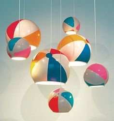 beach ball lamps #Window #Display.. with a couple adirondack chairs and colorful buckets!