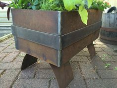 This welded steel planter box is 12 x 12 x 16 and sits on two arched steel legs, and features a raised band around the middle. Not your size?