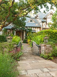With half-timber and lath walls, a turret, carved rafter tails, leaded glass, and reclaimed wood and stone floors—this home looks as if it could have been gently plucked from the pages of a fairy tale. - Photo: John Granen