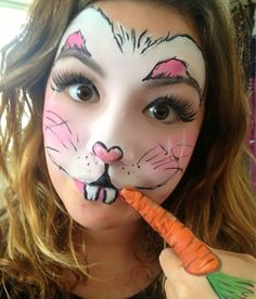 Cute bunny....though I'd definitely would make bigger ears. Love the finger used for carrot!