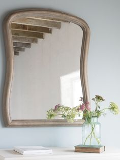 Loaf's Cinch mirror with a hand-carved wooden frame