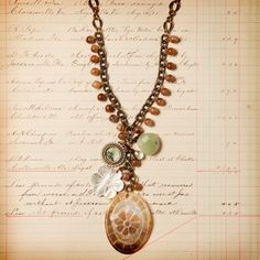 Flower Shell Necklace  by Jill Schwartz  Hanging from its chain, you'll find carnelian, mother of pearl, lemon quartz, turquoise and freshwater pearl, among other curious elements. fab.com  I love every piece of jewelry she sells!!