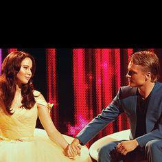 Katniss Everdeen and Peeta Mellark holding hands in their interview after the hunger games. #movie #screenshot