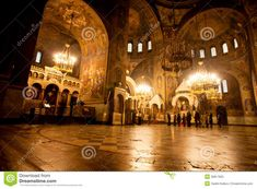 People pray inside the bright Cathedral. Photo about eastern, candles, indoor, culture, altar, building, holy, architecture, ceiling, catholicism - 39817825