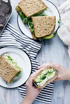 A green sandwich bursting at the seams with herbed goat cheese, avocado, alfalfa, and more.